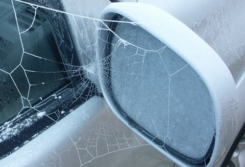 spider-web-on-car-mirror